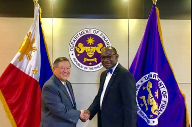 Philippines secretary of finance Carlos Dominguez and FIDIC chief executive Nelson Ogunshakin pictured at the Department of Finance.