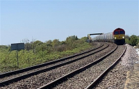 Network Rail fully reopens one of most important freight lines in Britain after an unprecedented repair operation, helping keep the country's lights on in the fight against Covid-19.