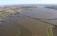 Photo shows extent of previous flooding of railway line near Drax power plant.