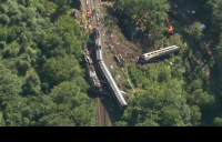 """Rail chief """"acutely aware we need a long-term resolution"""" to protect against climate change following fatal derailment."""